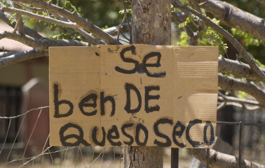 A hand-lettered sign see alongside a country road on Santa Elena Peninsula in Northwest Costa Rica.  There are many beaches here, which are usually not crowded - and you can get cheap, fresh cheese.