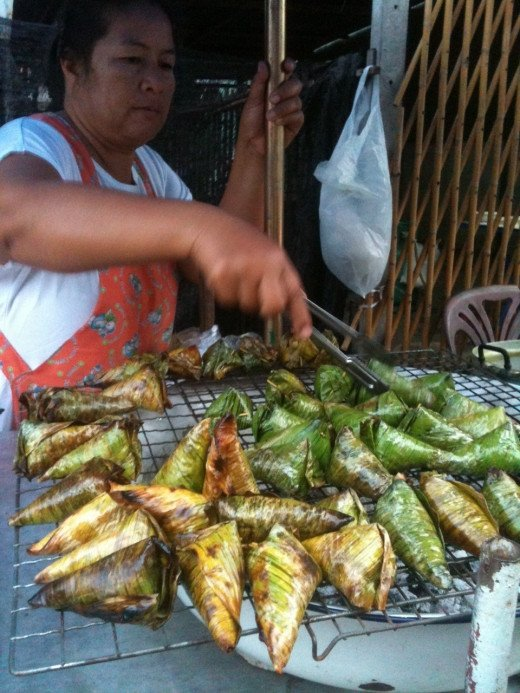 Sweet Glutinous Rice Being Grilled in Banana Leaves - Bangkok, Thailand
