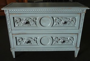 This is a pretty, ornate dresser or sideboard. Notice how the edges are quite worn out. This is an intentional look!