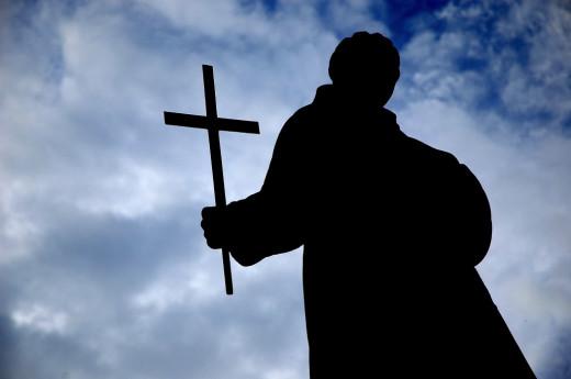 A statue holding a cross