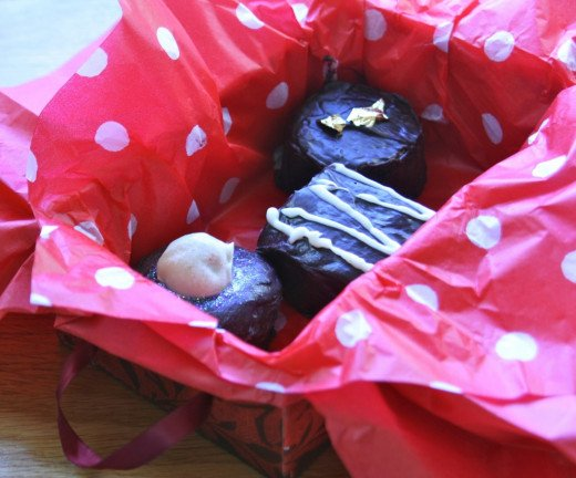 Have a try at making your own chocolates and pop in a handmade box with spotty tissue paper