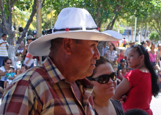 Part of my hats of the fiestas series, which is a work in progress.  Man and his wife standing along the parade route.