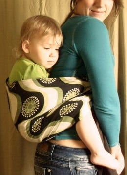 A sleepy-eyed Ember cuddling with mom.