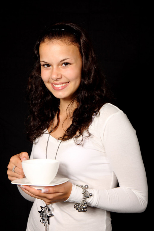 Young woman drinking tea. Tea is accessible to everybody nowadays.