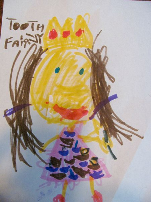 The Tooth Fairy wears a crown and has a big smile. She loves her job.