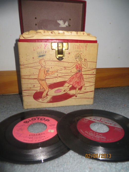My old record case with two 45 rpms showing.