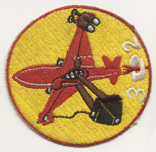 "302nd shoulder patch-shows the RF80 (""Shooting Star"") reconnaissance fighter with binoculars on the port wing and a camera slung below, plus jet smoke forming the numberals, ""302"" at the tail"