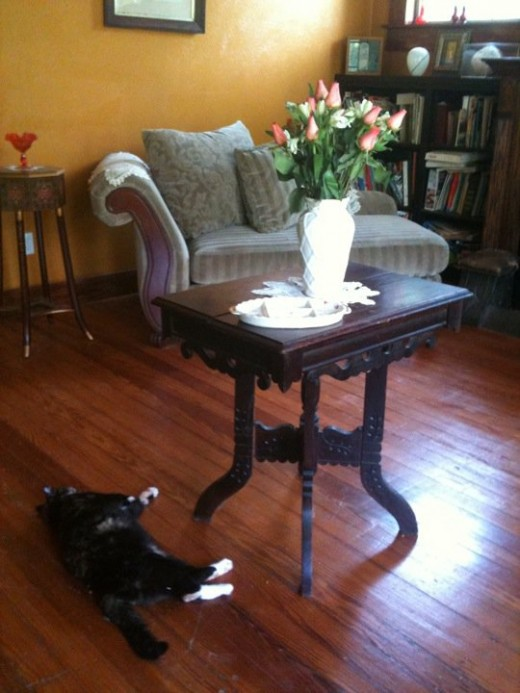 You can often find vintage furniture for pennies at flea markets and garage sales. This little table is perfect for the middle of my reception parlor.