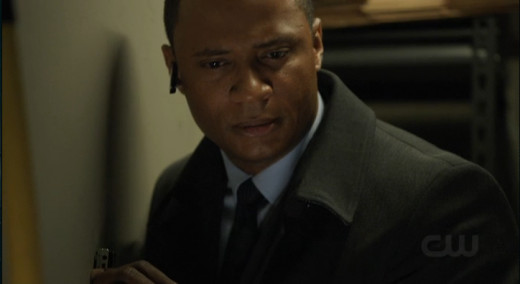 Diggle can hear Moira's voice clearly through the wall, but Merlyn's voice is somehow muffled.