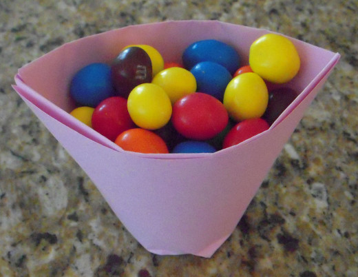Folded paper cup stands by itself and holds 48 peanut M&Ms.