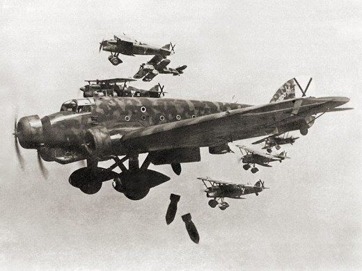 Italian heavy bombers dropping bombs on Madrid in 1936. Incidentally the black crosses are the symbol of the Spanish Air Force.
