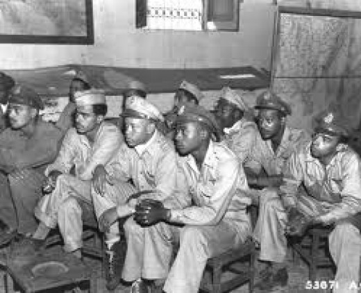 While some outgroup members remained as inconspicuous as possible,others fought against the blatant discrimination,asserting themselves to be just as equal as ingroup membersTuskegee Airmen of World War II, excellent pilots.