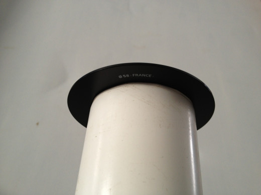 "A piece of 2"" PVC pipe with filter adapter attached... Slides over your current zoom lens"