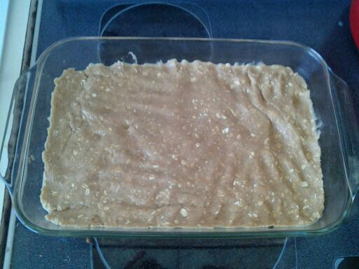 Cookie dough pressed into the pan