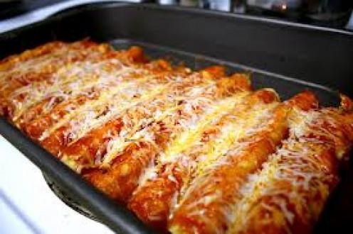 Cheesy chicken enchiladas are a delicious Mexican dish.