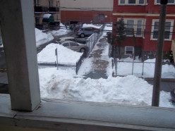 Why would someone shovel or plow the snow in front of a driveway cleared of snow?