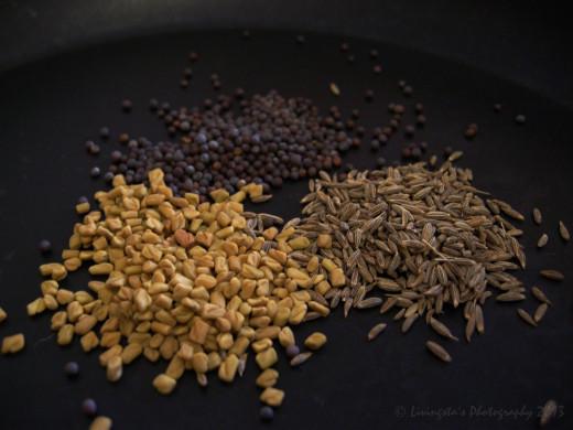 Ingredients clockwise from bottom left Fenugreek seeds, Mustard seeds, Cumin seeds
