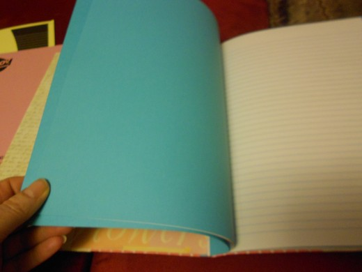 Insert plain paper or card stock to a lined book. Fix in place with butterfly fasteners.
