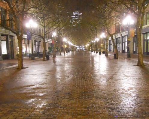 Occidental Park cobblestone mall at night.