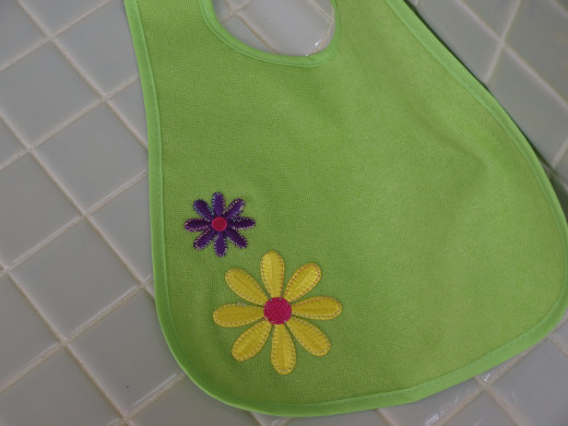 The finished baby bib ready for the gift basket!