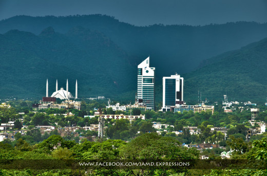 a view of Islamabad with Faisal Mosque and Margalla hills in the backdrop.