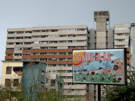 Angelo Lucia photographed this apartment builing in La Lisa, a municipality located west of Havana, on August 13, 2006. The sign belongs to a nearbly nursery school.