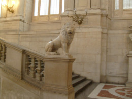 One of a pair of marble lions growls at unwanted anti-royalists.