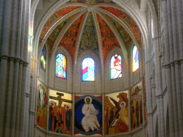 The dome interior is decorated with more artwork and stained glass