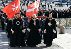 Knights of Malta celebrating 900 yrs at the Vatican. Pope Benedict was a member. Their  Anthem is 'Ave Crux Alba' (Latin). Which means 'Hail, thou White Cross'