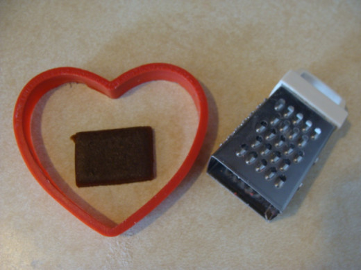 I used a mini grater as an impromptu cookie cutter for the mouth.