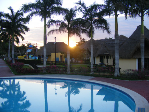 Sun coming up over the main pool. Allegro Resort. Cozumel, Mexico