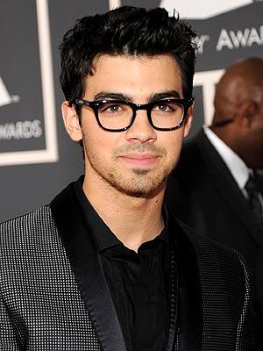 Joe Jonas loves the geek chic fashion.