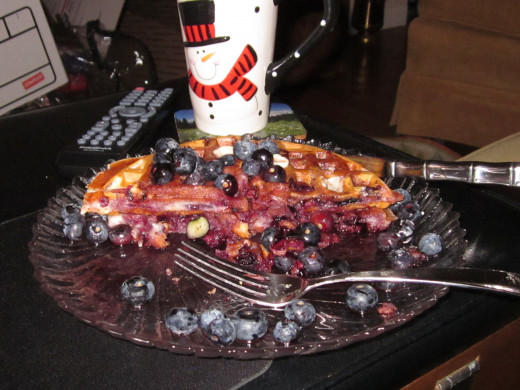 14. Delicious Blueberry Waffles with Organic Blueberry Syrup and butter and more blueberries...  Feel good food