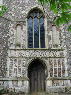 The church of St John the Baptist, Coltishall - west doorway.