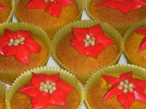 gorgeous sesame turmeric cupcakes with a rosewater frosting and topped off with pine nuts. Yummy!