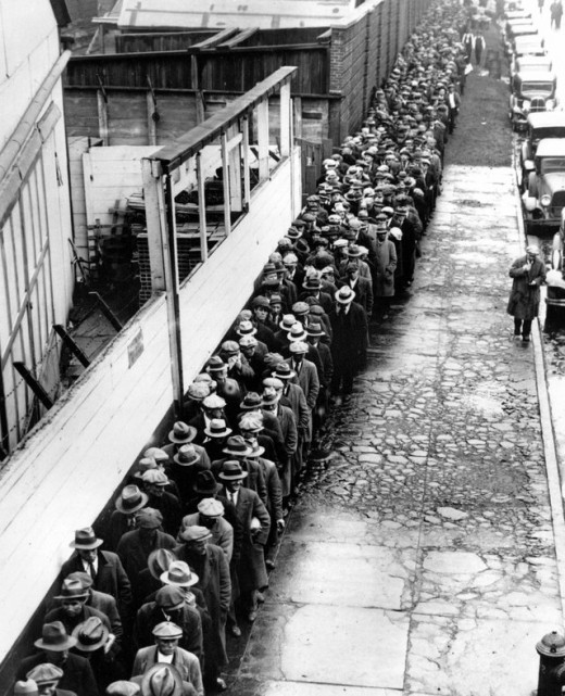 Homeless and jobless men wait outside to get free dinner during the Great Depression""