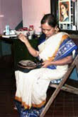 Mrs. Shashikala S Bhat, doing her embroidery work at  her home