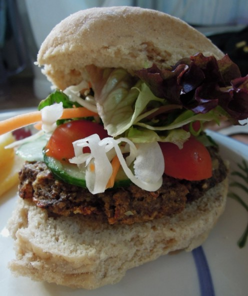 Vegan mushroom burger with salad.