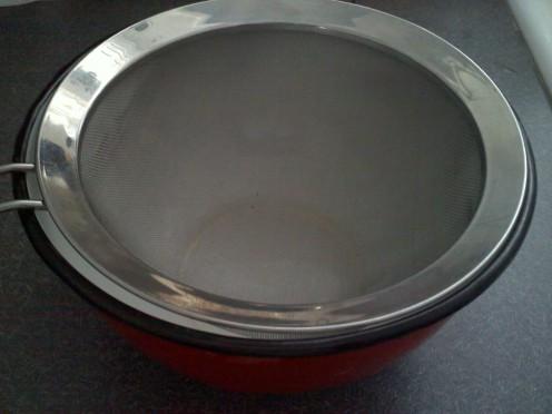 Mesh strainer over bowl