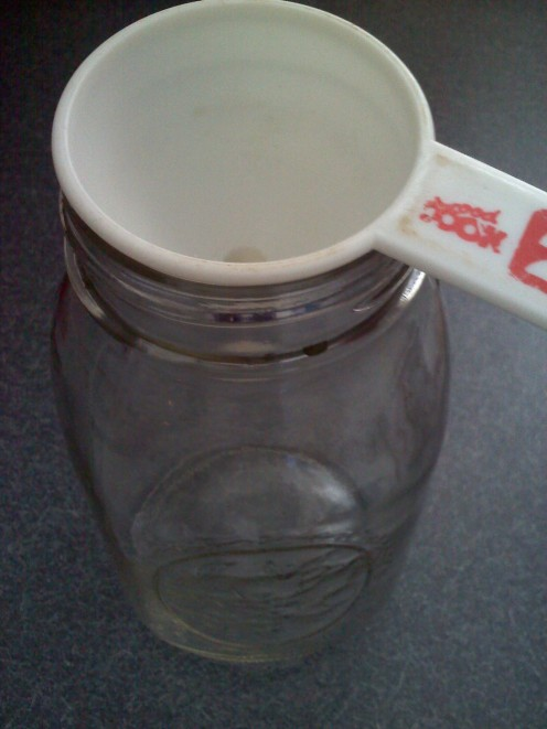 Funnel over cleaned out mason jar