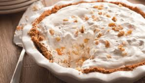 Millionaire Pie is a Dessert that has nuts, fruits and whipped cream.