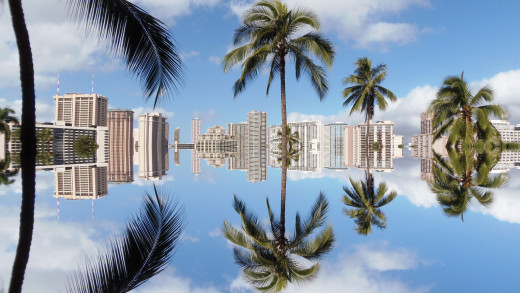 View of Waikiki hotels on a bright sunny day, like most days, with the reflecting sky below