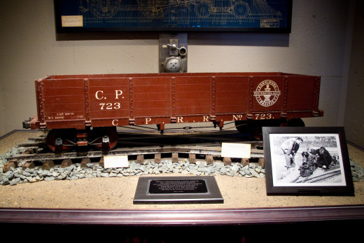 "This Disney Gallery display shows the original Lilly Belle Blueprint, a photo of Walt Disney with his beloved Carolwood Pacific train, and the last remaining section of track from Walt's Holmby Hills railroad, built by the first ""Imagineer."""