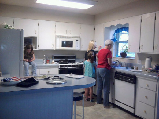 Helping out in the kitchen makes it a more friendly visit for you and your hostess!