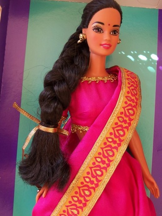 A wide bordered saree clad Indian Barbie