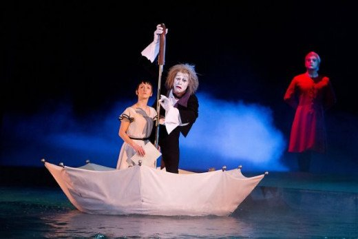 A magical unmbrella boat ride is just one of the incredible scenes that come to life in Cirque du Soleil: Worlds Away