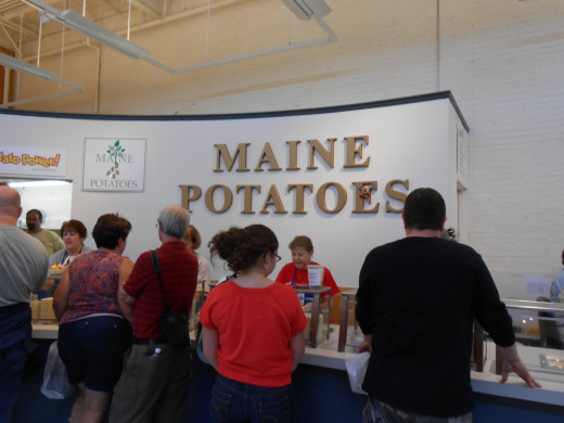 The line for the Maine baked potatoes inside the Maine Building.