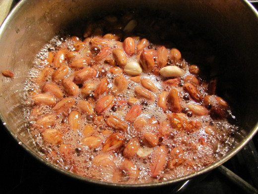 peanuts boiling in water and sugar mixture