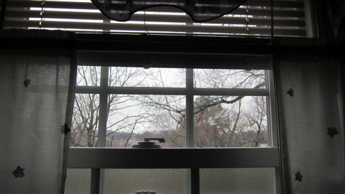 A view through a bathroom window captures the aftermath of a bad storm.
