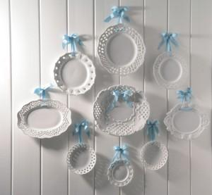 Shabby chic home accessories: wall of plates.